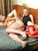 Voluptuous chick with enormous strap-on fucking a sissy guy in doggystyle