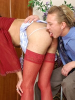 Kinky sissy guy in a red blouse and matching stockings riding a meaty pole