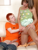 Hot sissy in a green top and a matching skirt surrenders to gay interaction